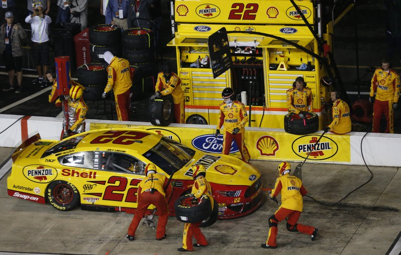 Joey Logano makes a pit stop during the NASCAR Cup Series auto race at Richmond Raceway in Richmond, Va. (AP Photo/Steve Helber)