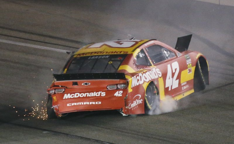 Kyle Larson backs his car down the track after he spun during the NASCAR Cup series auto race at Richmond Raceway in Richmond, Va. (AP Photo/Steve Helber)