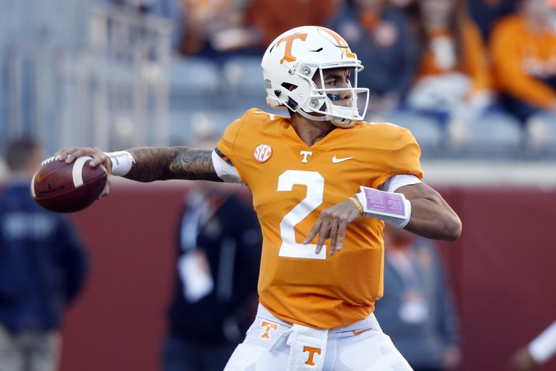 FILE - In this Nov. 17, 2018, file photo, Tennessee quarterback Jarrett Guarantano warms up before an NCAA college football game against Missouri in Knoxville, Tenn. (AP Photo/Wade Payne, File)
