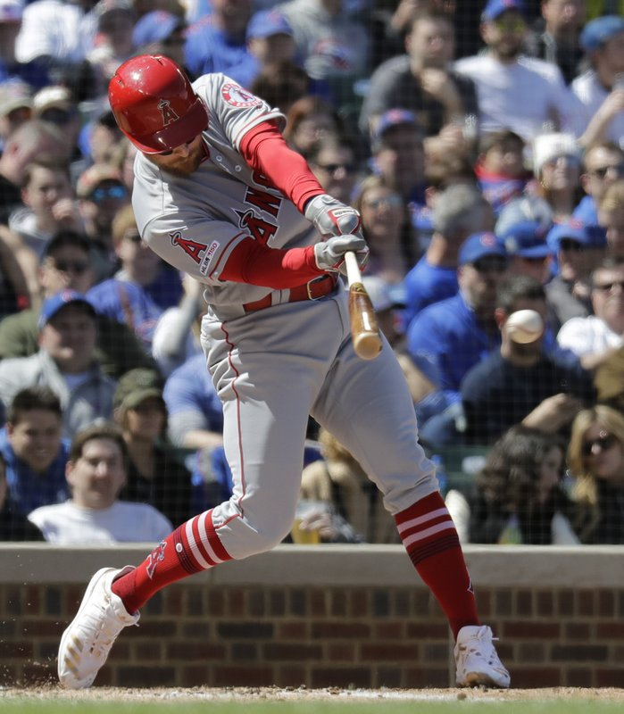 Los Angeles Angels' Zack Cozart hits an RBI single during the second inning of a baseball game against the Chicago Cubs, Saturday, April 13, 2019, in Chicago. (AP Photo/Nam Y. Huh)