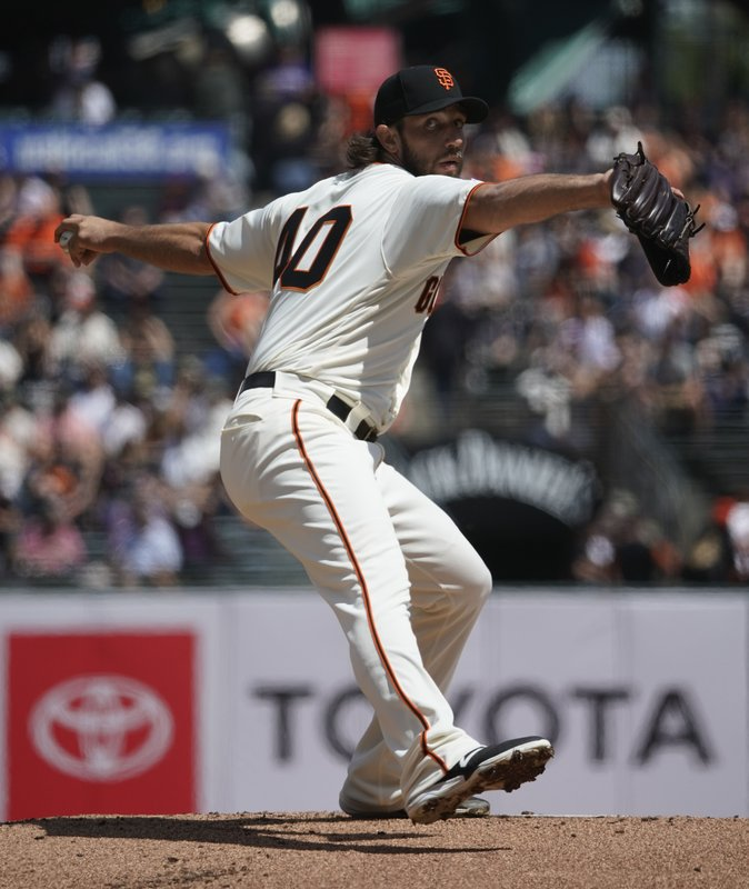 San Francisco Giants pitcher Madison Bumgarner works against the Colorado Rockies during the first inning of a baseball game Saturday, April 13, 2019, in San Francisco. (AP Photo/Tony Avelar)