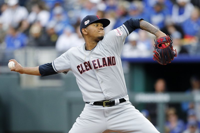 Making his major league debut, Cleveland Indians pitcher Jefry Rodriguez throws to a batter in the first inning of a baseball game against the Kansas City Royals at Kauffman Stadium in Kansas City, Mo. (AP Photo/Colin E. Braley)