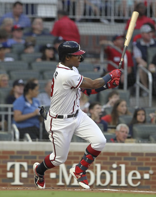 Atlanta Braves' Ronald Acuna Jr. watches his RBI single against the New York Mets during the first inning of a baseball game Saturday, April 13, 2019, in Atlanta. (AP Photo/Tami Chappell)