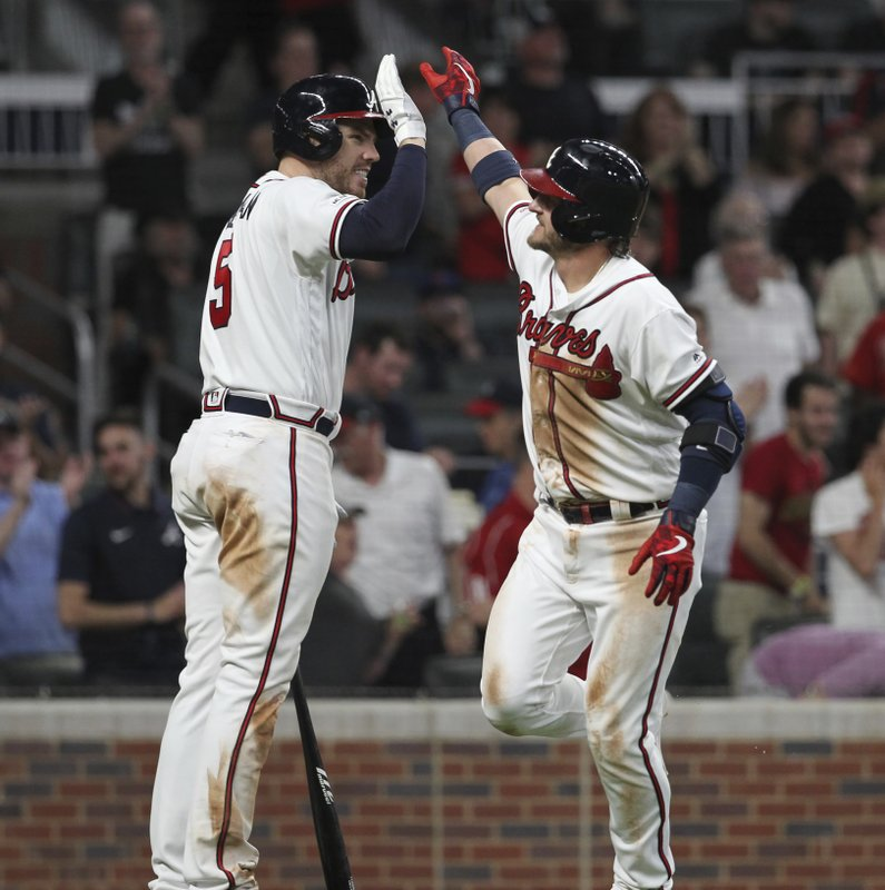 Atlanta Braves' Josh Donaldson, right, celebrates with Freddie Freeman after a solo home run against the New York Mets during the seventh inning of a baseball game Saturday, April 13, 2019, in Atlanta. (AP Photo/Tami Chappell)