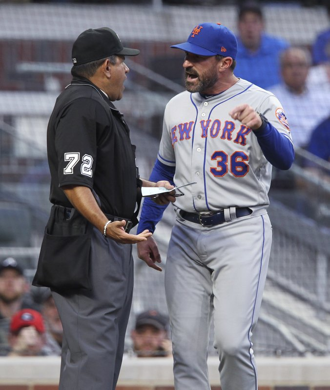 New York Mets manager Mickey Callaway, right, reacts after being ejected by home plate umpire Alfonso Marquez during the first inning of the team's baseball game against the Atlanta Braves on Saturday, April 13, 2019, in Atlanta. (AP Photo/Tami Chappell)