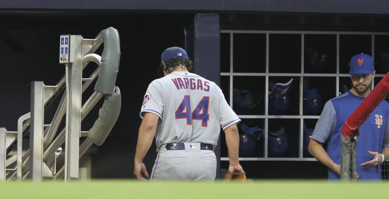 New York Mets pitcher Jason Vargas enter the dugout after pulled from the team's baseball game against the Atlanta Braves during the first inning Saturday, April 13, 2019, in Atlanta. (AP Photo/Tami Chappell)