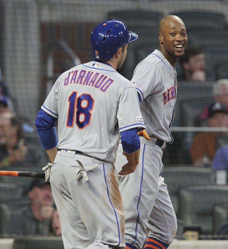 New York Mets' Travis d'Arnaud, left, and J.D. Davis celebrate after scoring against the Atlanta Braves during the first inning of a baseball game Saturday, April 13, 2019, in Atlanta. (AP Photo/Tami Chappell)