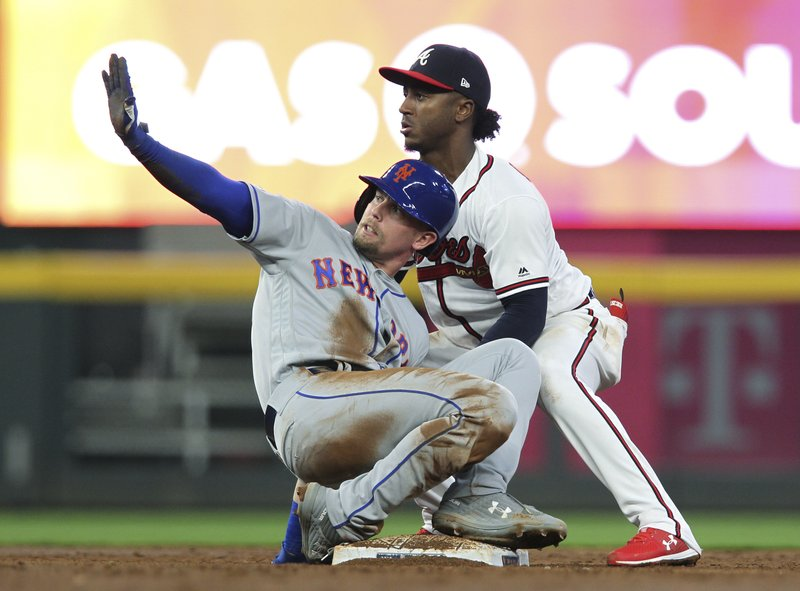 New York Mets' Jeff McNeil calls time after reaching second base, advancing on a fly out by Pete Alonso, as Atlanta Braves' Ozzie Albies, applies the tag during the second inning of a baseball game Saturday, April 13, 2019, in Atlanta. (AP Photo/Tami Chappell)