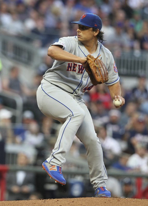New York Mets' Jason Vargas pitches against the Atlanta Braves during the first inning of a baseball game Saturday, April 13, 2019, in Atlanta. (AP Photo/Tami Chappell)