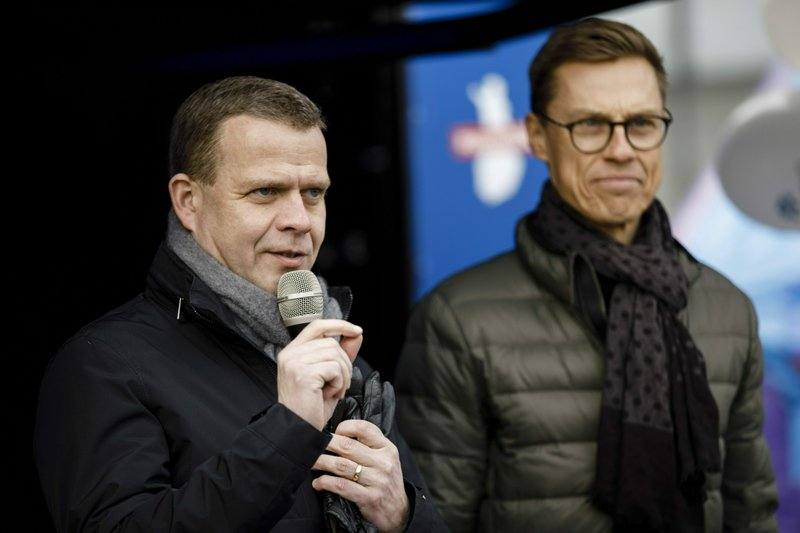 The chairman of the National Coalition Party and parliamentary candidate Petteri Orpo, left, with Vice President of European Investment Bank Alexander Stubb campaign for parliamentary elections in Helsinki, Finland, on Saturday, April 13, 2019. (Seppo Samuli/Lehtikuva via AP)