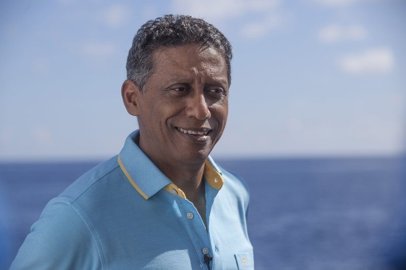 In this Saturday, April 13, 2019, photo, Seychelles President Danny Faure smiles during an interview with the Associated Press, on board the vessel Ocean Zephyr off the coast of Desroches, in the outer islands of Seychelles. (AP Photo/Steve Barker)