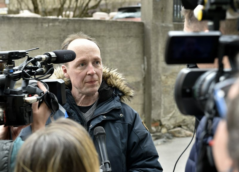 The chairman of the Finns Party and parliamentary candidate Jussi Halla-aho talks with media on his way to cast his vote in the parliamentary elections, in Helsinki, in Helsinki, Finland Sunday, April 14, 2019. (Emmi Korhonen/Lehtikuva via AP)