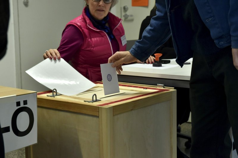A man casts his vote in the parliamentary elections in Helsinki Finland on Sunday April 14, 2019. Finns are voting in a parliamentary election in which reforming the nation's generous welfare model and tackling climate change have emerged as key issues.(Emmi Korhonen/Lehtikuva via AP)