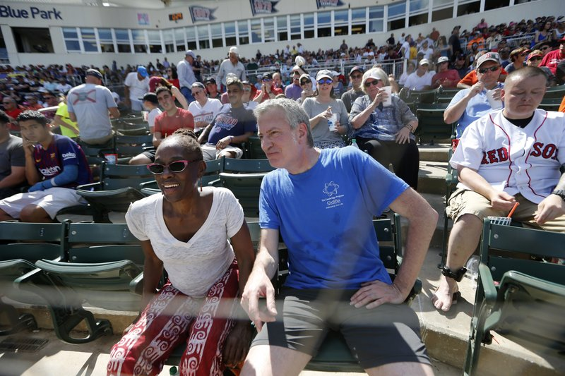 FILE - This March 2, 2019 file photo shows New York City Mayor Bill de Blasio and his wife Chirlane McCray between innings of a spring training baseball game between the Boston Red Sox and the Baltimore Orioles in Fort Myers, Fla. (AP Photo/Gerald Herbert, File)