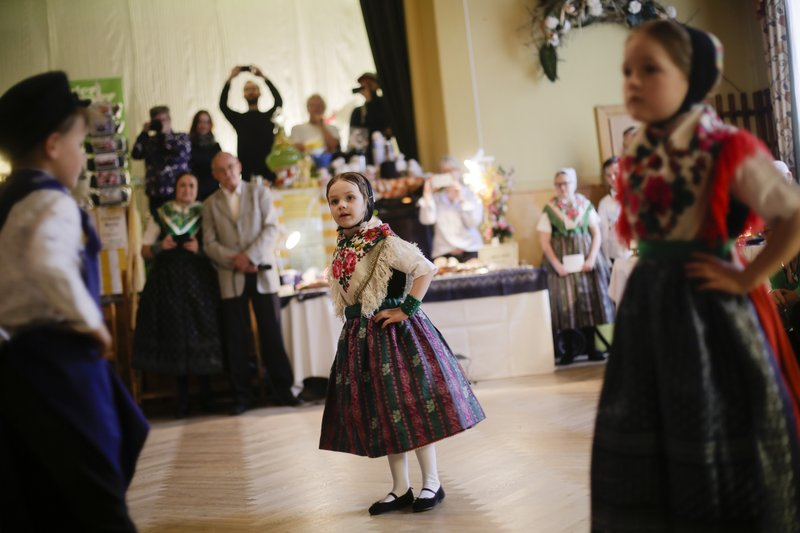 Children are dressed in traditional Sorb clothes perform at an Easter Market of Germany's Sorb minority in the village Neuwiese, near the city of Hoyerswerda in east Germany, Sunday, April 14, 2019. (AP Photo/Markus Schreiber)