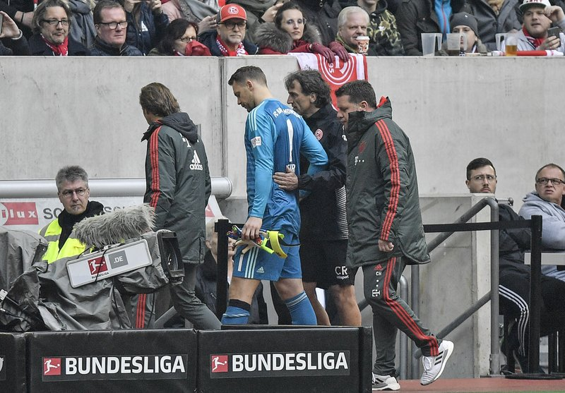 Bayern goalkeeper Manuel Neuer leaves the pitch injured during the German Bundesliga soccer match between Fortuna Duesseldorf and Bayern Munich in Duesseldorf, Germany, Sunday April 14, 2019. (AP Photo/Martin Meissner)