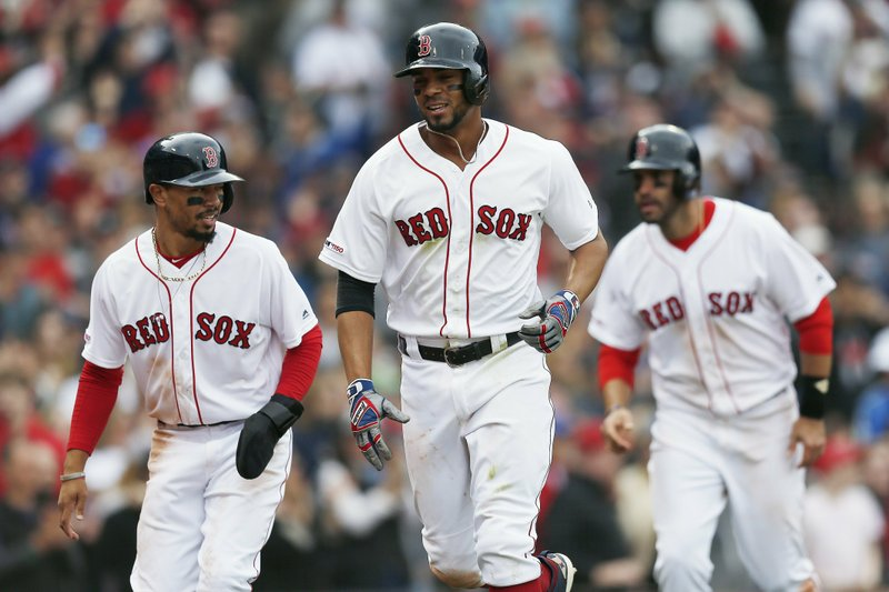 Boston Red Sox's Xander Bogaerts, center, celebrates his three-run home run that also drove in Mookie Betts, left, and J. (AP Photo/Michael Dwyer)