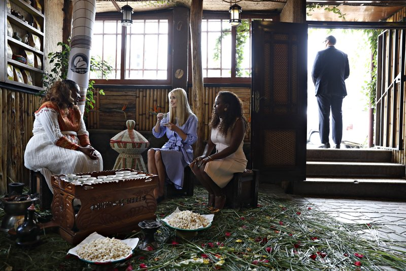 White House senior adviser Ivanka Trump, center, attends a coffee ceremony at Dumerso Coffee, Sunday April 14, 2019, in Addis Ababa, Ethiopia, with Kidist Birhanu, left, and Eleni Melesse, with USAID, right. (AP Photo/Jacquelyn Martin)