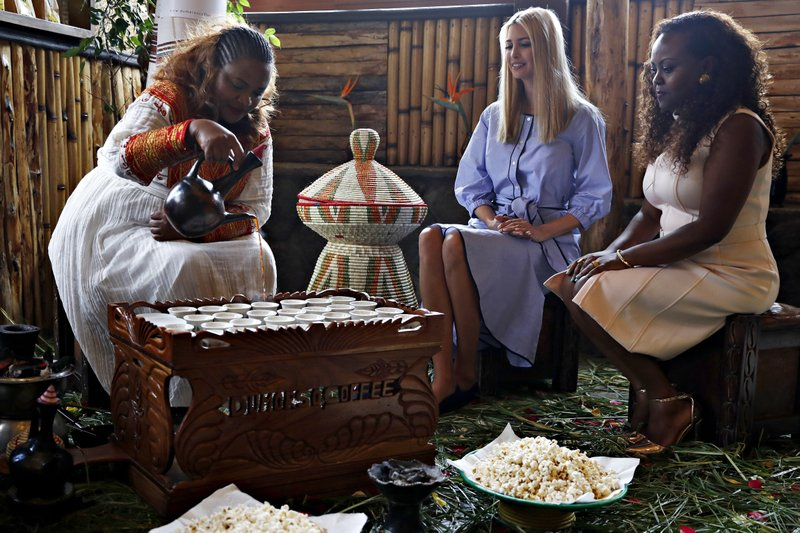 White House senior adviser Ivanka Trump, center, attends a coffee ceremony at Dumerso Coffee, Sunday, April 14, 2019, in Addis Ababa, Ethiopia, with Kidist Birhanu, left, and Eleni Melesse, with USAID, right. (AP Photo/Jacquelyn Martin)