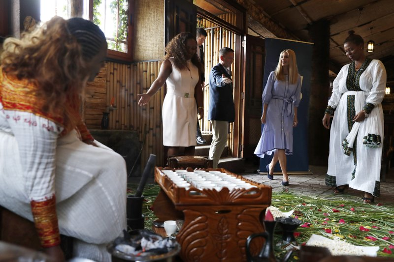 White House senior adviser Ivanka Trump, with Dumerso Coffee cafe owner Hirut Birhanu, right, is welcomed to a coffee ceremony at the cafe, Sunday April 14, 2019, in Addis Ababa, Ethiopia. (AP Photo/Jacquelyn Martin)