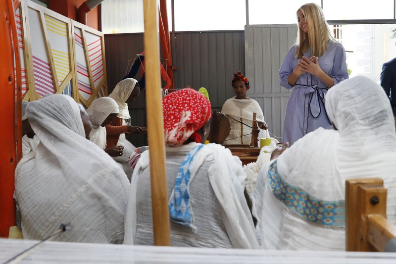 White House senior adviser Ivanka Trump, reacts to a warm greeting from traditional weavers during a tour of Muya, a manufacturing center of textiles and traditional crafts, Sunday April 14, 2019, in Addis Ababa, Ethiopia. (AP Photo/Jacquelyn Martin)
