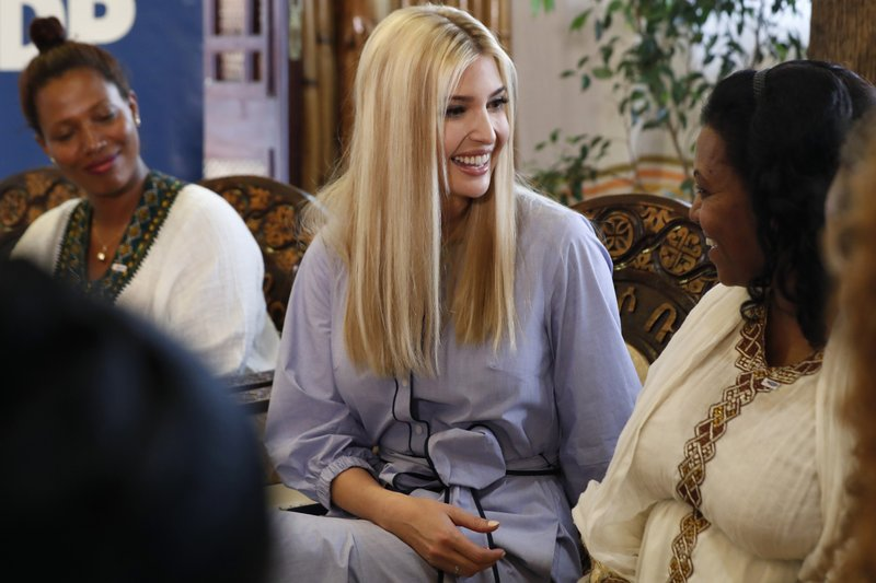 White House senior adviser Ivanka Trump, center, smiles at Azalech Tesfaye, right, who is the recipient of loan guarantee through USAID, as Trump meets women who work in the Ethiopian coffee industry, Sunday April 14, 2019, at Dumerso Coffee in Addis Ababa, Ethiopia. (AP Photo/Jacquelyn Martin)