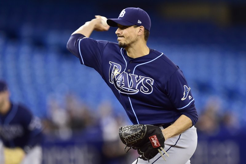 Tampa Bay Rays starting pitcher Charlie Morton (50) delivers a pitch to home plate during first inning baseball action against the Toronto Blue Jays in Toronto on Sunday, April 14, 2019. (Frank Gunn/The Canadian Press via AP)
