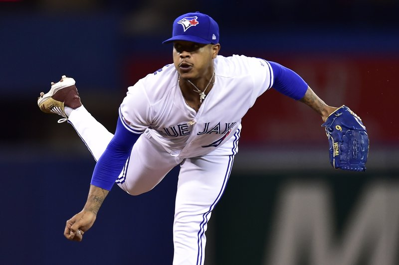 Toronto Blue Jays starting pitcher Marcus Stroman (6) delivers a pitch to home plate during first inning  baseball action against the Tampa Bay Rays in Toronto on Sunday, April 14, 2019. (Frank Gunn/The Canadian Press via AP)