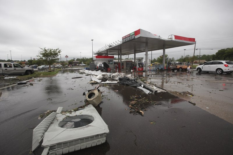 A gas station is damaged following severe weather, Saturday, April 13, 2019 in Vicksburg, Miss. Authorities say a possible tornado has touched down in western Mississippi, causing damage to several businesses and vehicles. (Courtland Wells/The Vicksburg Post via AP)