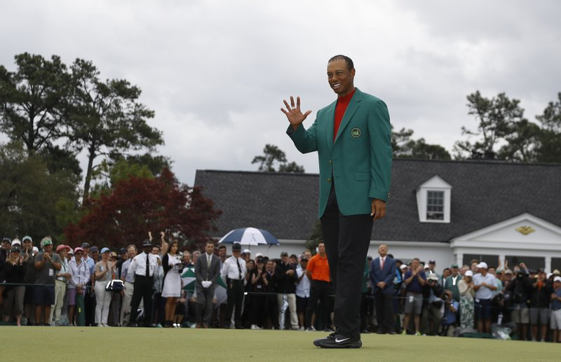 Tiger Woods wears his green jacket after winning the Masters golf tournament Sunday, April 14, 2019, in Augusta, Ga. (AP Photo/Matt Slocum)