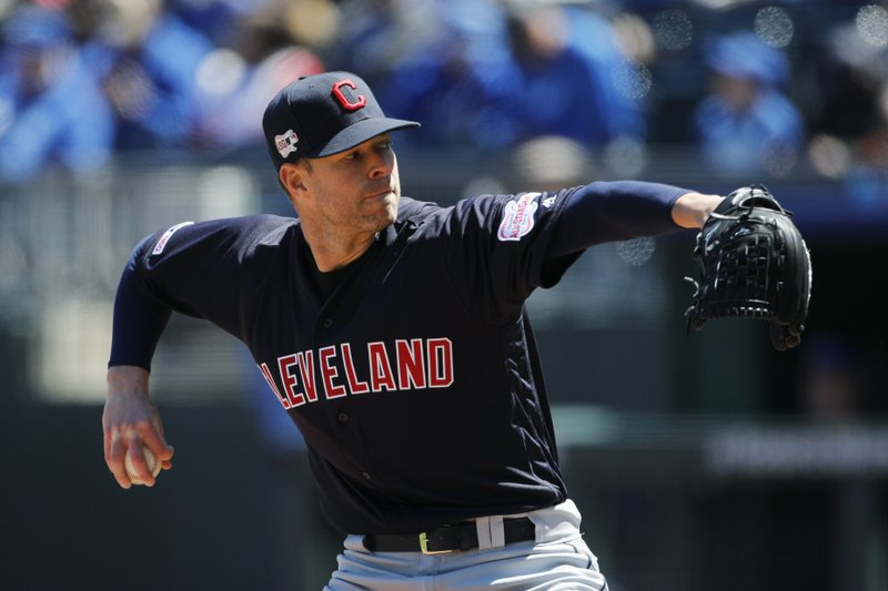 Cleveland Indians pitcher Corey Kluber throws to a Kansas City Royals batter in the first inning of a baseball game at Kauffman Stadium in Kansas City, Mo. (AP Photo/Colin E. Braley)