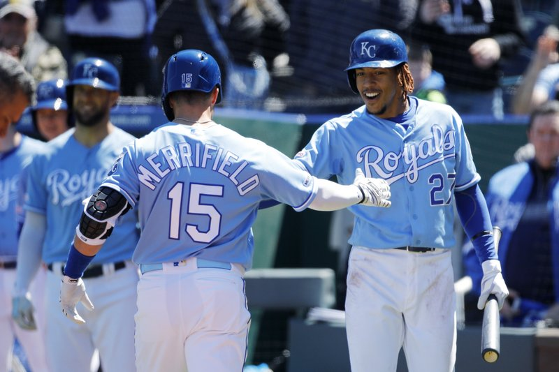 Kansas City Royals' Whit Merrifield (15) is congratulated by Adalberto Mondesi (27) after hitting a home run in the second inning of a baseball game against the Cleveland Indians at Kauffman Stadium in Kansas City, Mo. (AP Photo/Colin E. Braley)