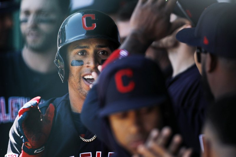 Cleveland Indians' Leonys Martin is congratulated in the dugout after hitting a solo home run in the first inning of a baseball game against the Kansas City Royals at Kauffman Stadium in Kansas City, Mo. (AP Photo/Colin E. Braley)