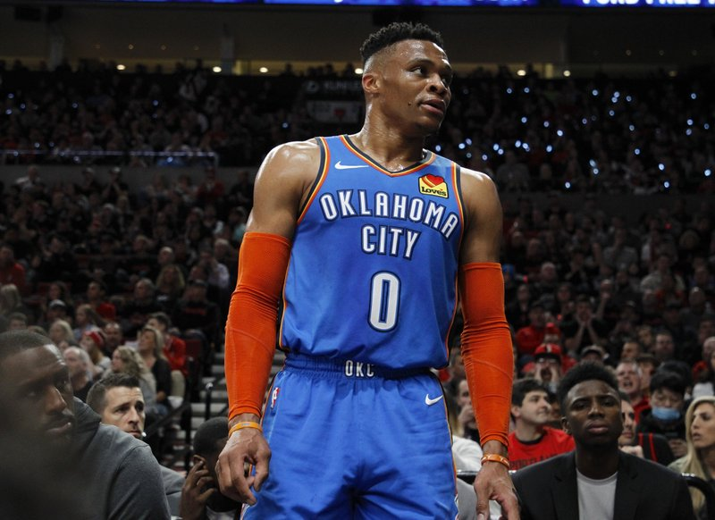 Oklahoma City Thunder guard Russell Westbrook interacts with the crowd during the first half of Game 1 of a first-round NBA basketball playoff series against the Portland Trail Blazers in Portland, Ore. (AP Photo/Steve Dipaola)