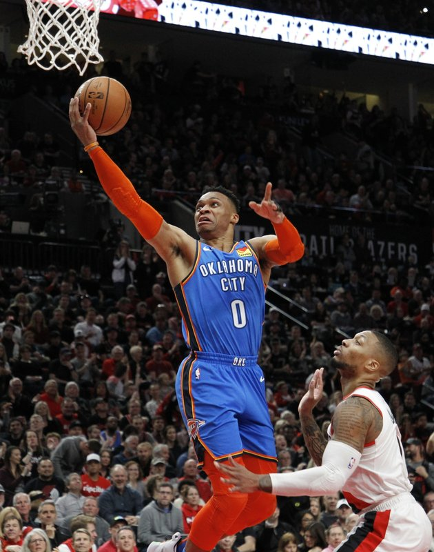 Oklahoma City Thunder guard Russell Westbrook, left, shoots as Portland Trail Blazers guard Damian Lillard, right, defends during the first half of Game 1 of a first-round NBA basketball playoff series in Portland, Ore. (AP Photo/Steve Dipaola)