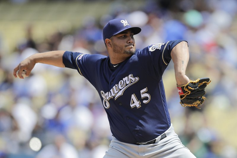 Milwaukee Brewers starting pitcher Jhoulys Chacin throws against the Los Angeles Dodgers during the first inning of a baseball game, Sunday, April 14, 2019, in Los Angeles. (AP Photo/Jae C. Hong)