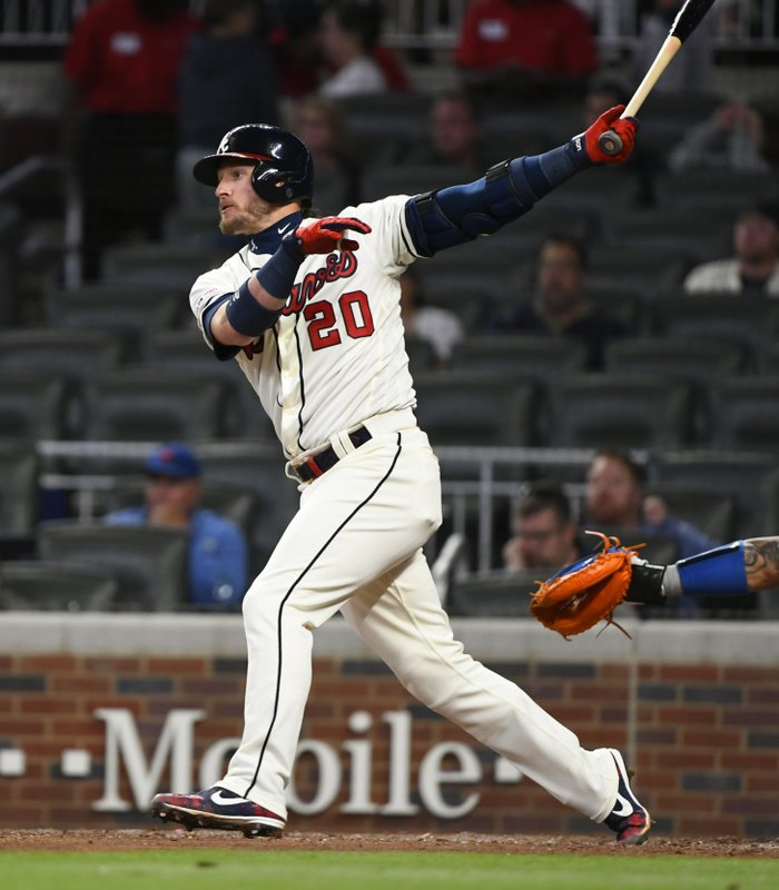 Atlanta Braves' Josh Donaldson follows through on his home run to center field during the fifth inning of a baseball game against the New York Mets, Sunday, April 14, 2019, in Atlanta. (AP Photo/John Amis)
