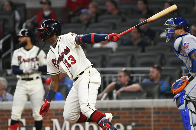 Atlanta Braves' Ronald Acuna Jr. watches his one-run single line drive to right field during the third inning of a baseball game against the New York Mets, Sunday, April 14, 2019, in Atlanta. (AP Photo/John Amis)