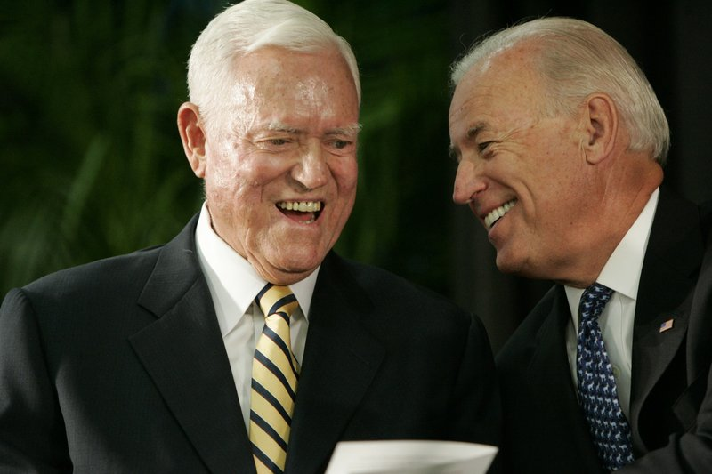 FILE - In this Friday, July 23, 2010, file photo, Vice President Joe Biden chats with former U.S. Sen. (AP Photo/Mary Ann Chastain, File)