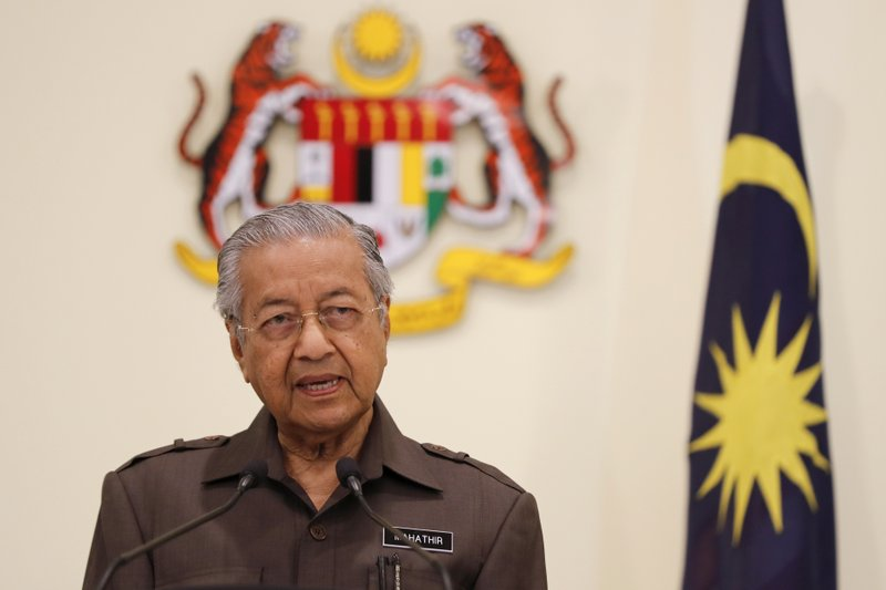 Malaysian Prime Minister Mahathir Mohamad speaks during a press conference in Putrajaya, Malaysia, Monday, April 15, 2019. (AP Photo/Vincent Thian)