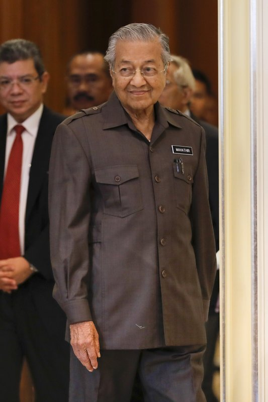 Malaysian Prime Minister Mahathir Mohamad arrives for a press conference in Putrajaya, Malaysia, Monday, April 15, 2019. (AP Photo/Vincent Thian)