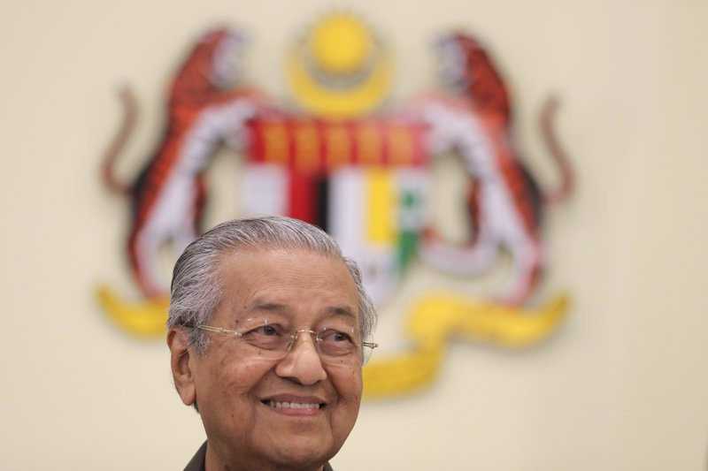 Malaysian Prime Minister Mahathir Mohamad smiles during a press conference in Putrajaya, Malaysia, Monday, April 15, 2019. (AP Photo/Vincent Thian)