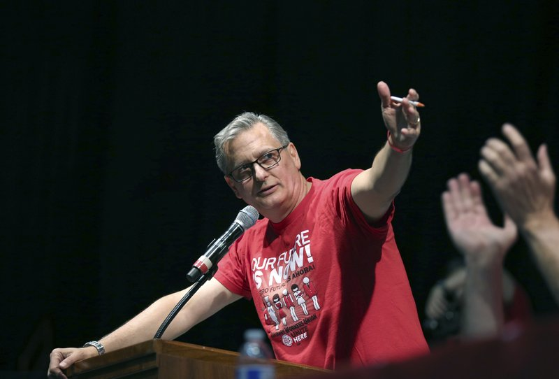 FILE - In this Tuesday, May 22, 2018, file photo, Ted Pappageorge, president of the Culinary Workers Union, Local 226, speaks before a vote on whether to authorize a strike, in Las Vegas. (Steve Marcus/Las Vegas Sun via AP, File)