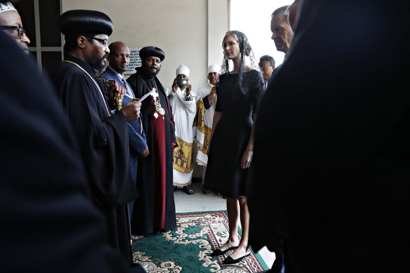 White House senior adviser Ivanka Trump, center, is greeted as she arrives for a ceremony at Holy Trinity Cathedral honoring the victims of the Ethiopian Airlines crash, Monday, April 15, 2019, in Addis Ababa, Ethiopia. (AP Photo/Jacquelyn Martin)