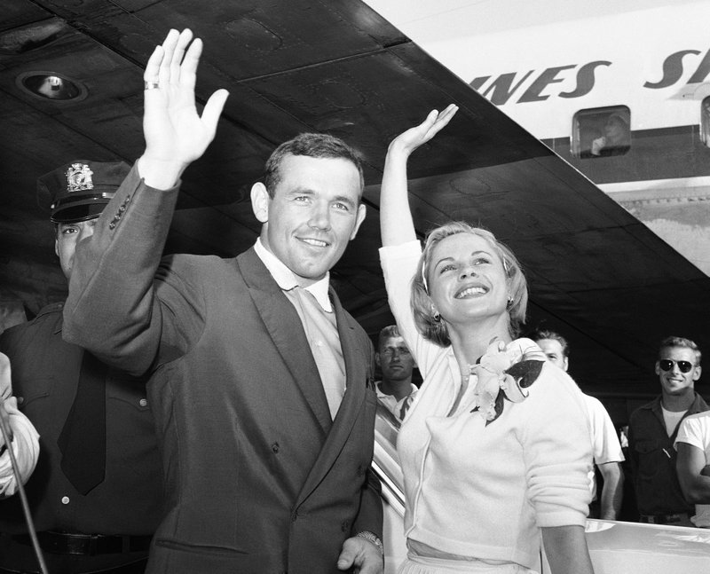 FILE - In this July 3, 1959 file photo, Swedish actress Bibi Andersson, right, and Sweden's Ingemar Johansson wave for the photographers at New York's Idlewild Airport. (AP Photo/Hans von Nolde, File)