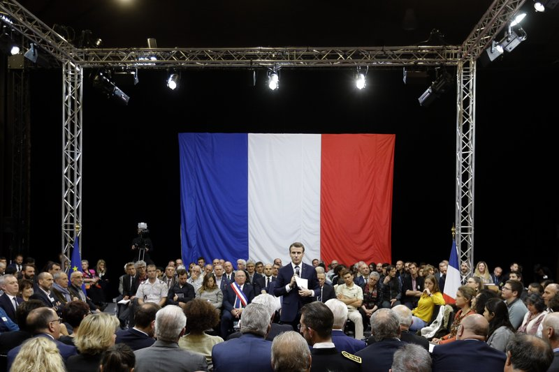FILE - In this March 7, 2019 file photo, French President Emmanuel Macron attends a meeting as part of the