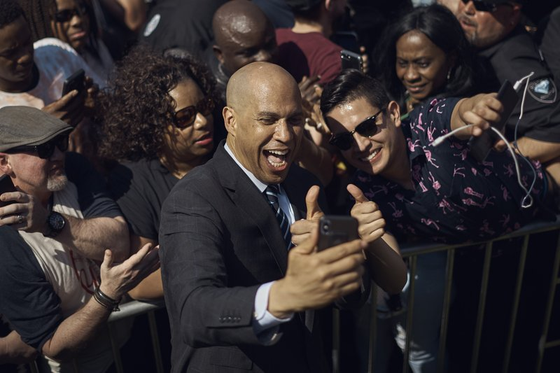 Cory Booker takes a selfie with his supporters during a hometown kickoff for his national presidential campaign tour at Military Park in downtown Newark, N. (AP Photo/Andres Kudacki)