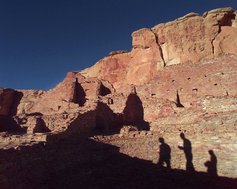 FILE - In this Nov. 21, 1996, file photo, tourists cast their shadows on the ancient Anasazi ruins of Chaco Canyon National Historic Park in New Mexico. (AP Photo/Eric Draper, File)