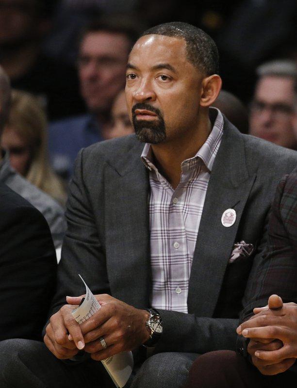 FILE - In this March 16, 2018, file photo, Miami Heat assistant coach Juwan Howard watches during a game against the Los Angeles Lakers in Los Angeles. (AP Photo/Ringo H.W. Chiu, File)