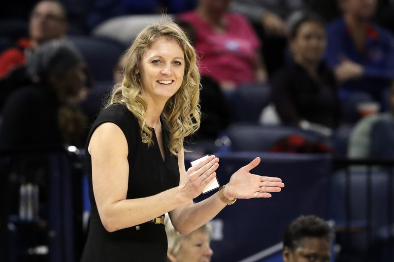 FILE - In this March 30, 2019, file photo, Missouri State head coach Kellie Harper smiles as he directs her team during the second half of a regional semifinal game against the Stanford in the NCAA women's college basketball tournament, in Chicago. (AP Photo/Nam Y. Huh, File)